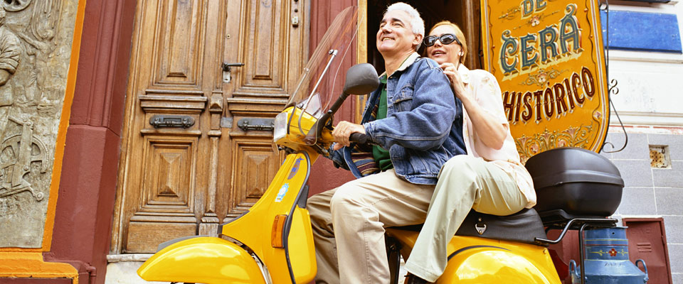 Allianz - Seniors riding a scooter
