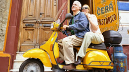 Seniors riding a scooter