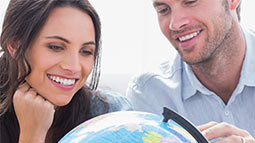 Allianz - couple looking at globe