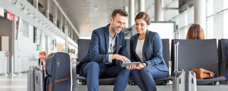 Allianz - business travelers looking at tablet