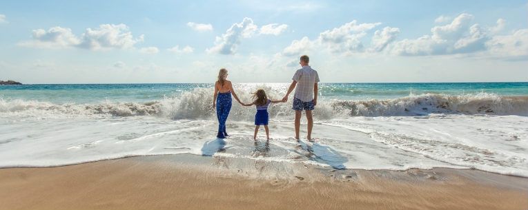 Allianz - parents and young child on family vacation at the beach