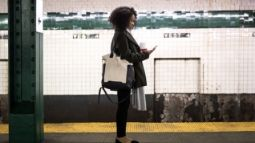 woman waiting for subway