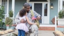 young girl and military father