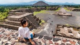 young female visits ancient Teotihuacan pyramids in Mexico City