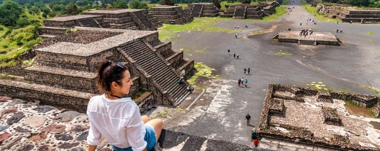 Allianz - young female visits ancient Teotihuacan pyramids in Mexico City